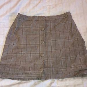Schoolgirl button front mini skirt